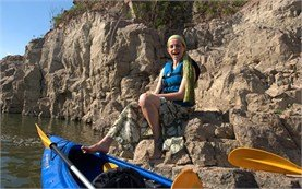 People on kayaking tours