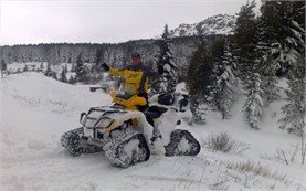 People participating in snowmobile adventures