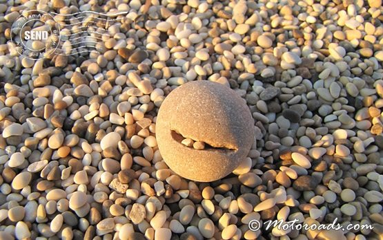 Smiling stone on the beach